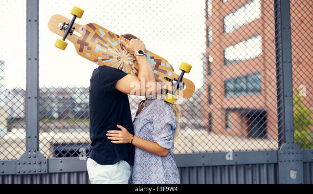 Sweet couple kissing and caressing each other - Stock Image