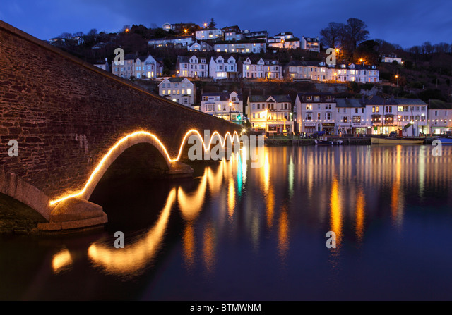 The road bridge across Looe River in south east Cornwall captured during twilight - Stock Image