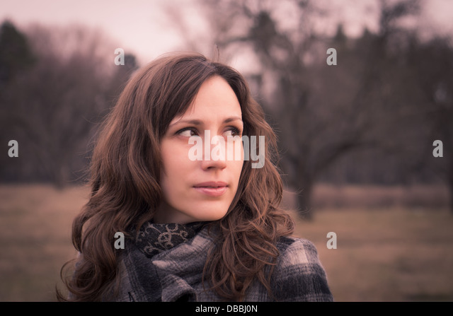 Outdoor Fashion portrait of Pretty Young woman. Posing in spring park - Stock Image