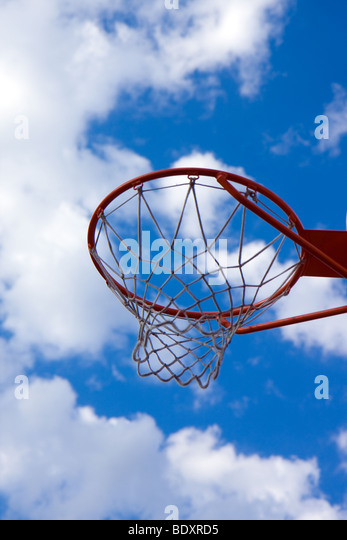 basketball hoop and blue sky - Stock Image