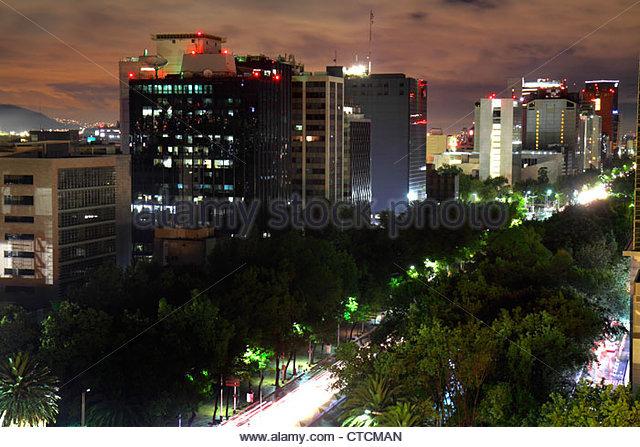 Mexico City Mexico DF D.F. Distrito Federal Cuauhtemoc Paseo de la Reforma city skyline night lights avenue trees - Stock Image