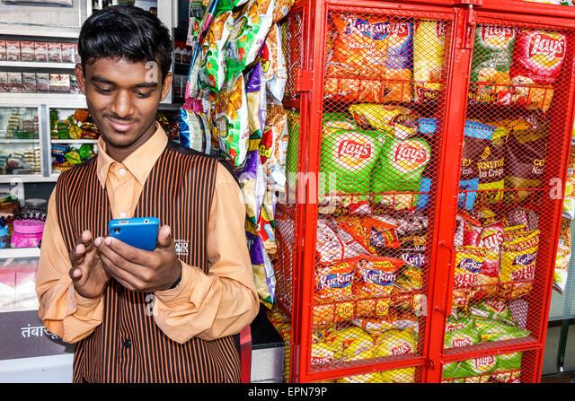 Mumbai India Asian Apollo Bandar Colaba Causeway Market Strand Road shopping vendor sale display man manager convenience - Stock Image