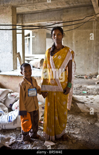 A mother and her child in the building site outside the new crèche of the Veera Desai Centre in Mumbai. - Stock Image