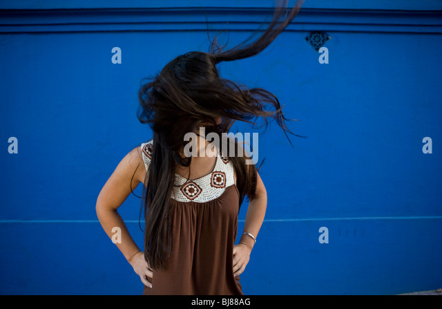 woman with wild, long, dark, straight, loose hair blowing in the wind - Stock-Bilder