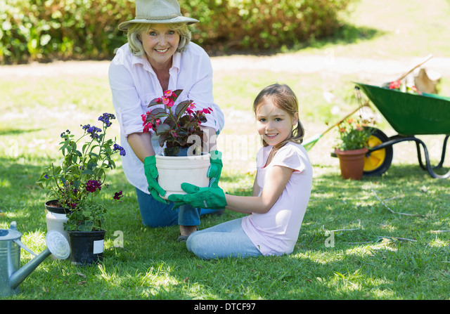 Grandmother and granddaughter engaged in gardening - Stock Image