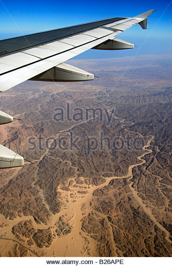 Aircraft wing above Egytian desert, Egypt, Africa - Stock Image