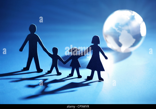 Paper chain family moving towards the light - Stock Image