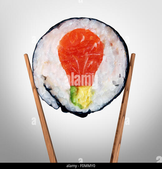 Sushi idea and Japanese food concept as a sushi roll with raw salmon and avocado shaped as a light bulb representing - Stock-Bilder
