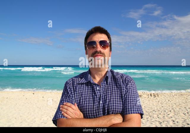 Nerd tourist mustache on caribbean beach mayan riviera - Stock Image