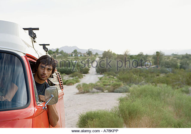 Young man in a camper van - Stock Image