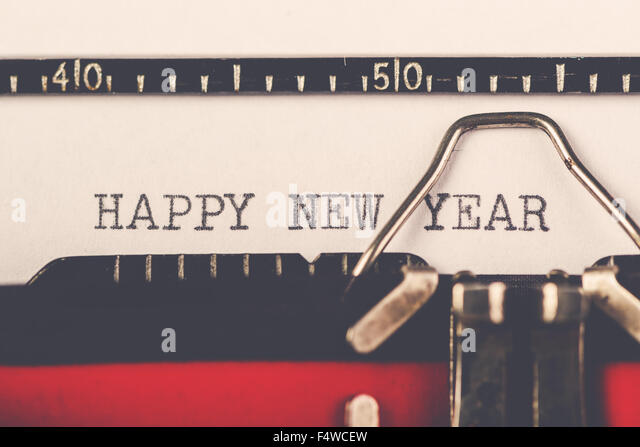 Happy New Year on old typewriter machine, hipster lifestyle holiday letter and greeting card, retro toned, selective - Stock-Bilder