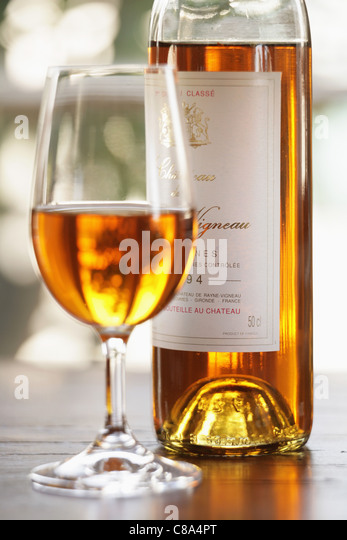 Bottle and glass of Sauternes - Stock Image