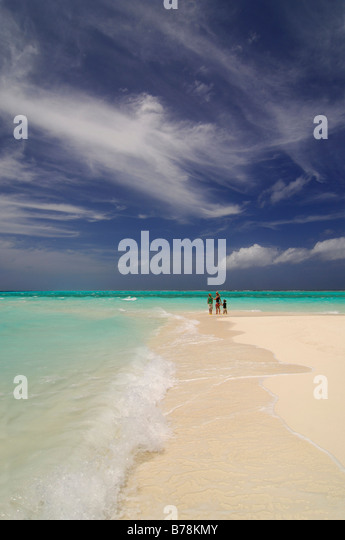 Woman and two children on the beach, Laguna Resort, The Maldives, Indian Ocean - Stock Image