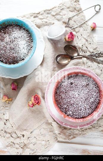 Homemade chocolate mug cake with icing sugar - Stock Image