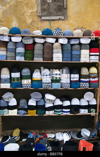 Stall selling hats worn by Muslim men.Traditional cotton KUFI hats. Modern knitted Kufi and Tarboush - a fez-style - Stock Image