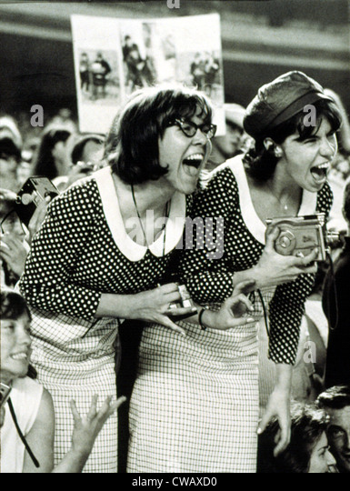BEATLES FANS scream at a concert at Shea Stadium, NY, 8/15/65, displaying what is called, 'Beatlemania.'. - Stock Image