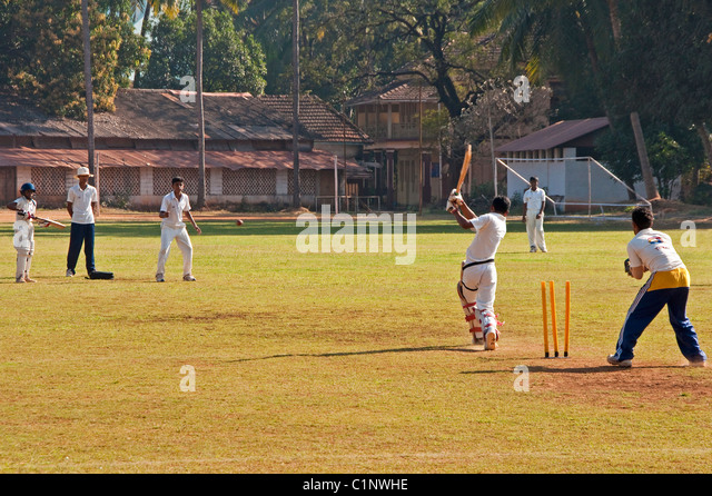 Schoolboys playing cricket in Panaji, Goa. - Stock Image