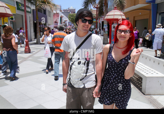 Chile Arica Paseo Peatonal 21 de Mayo pedestrian mall shopping business store Hispanic girl boy teen couple relationship - Stock Image