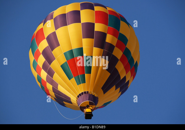 one hot air balloon in blue sky - Stock Image