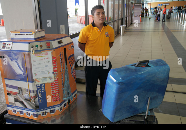 Panama City Panama Aeropuerto Tocumen airport PTY aviation terminal Secure Wrap baggage protection luggage plastic - Stock Image