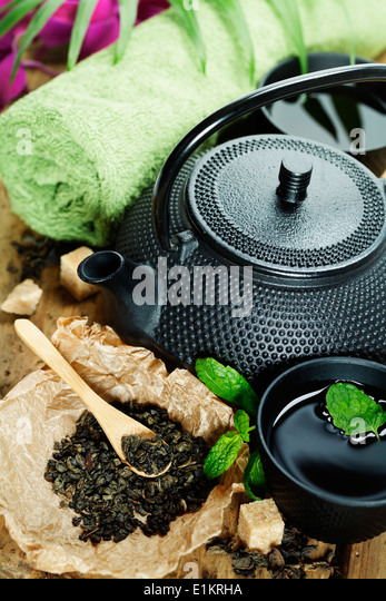 asian tea set and spa settings on wooden board - Stock Image