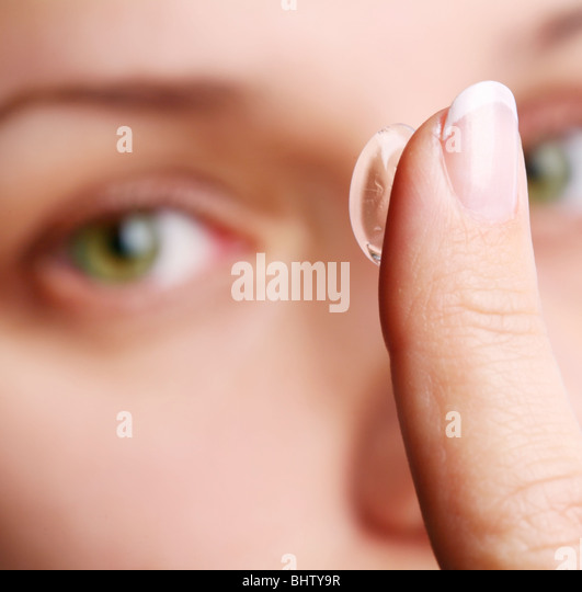 human eye with corrective lens on a white - Stock Image