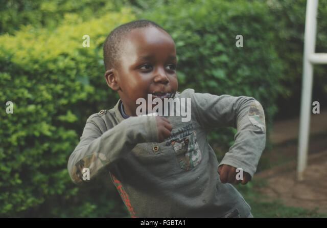 High Angle View Of Cute Boy Dancing In Park - Stock Image