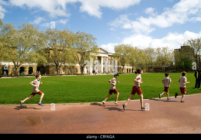Private school pupils jogging outside the Saatchi Gallery, London. UK. - Stock Image