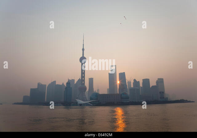 Sunrise over Pudong skyline, Shanghai, China - Stock Image