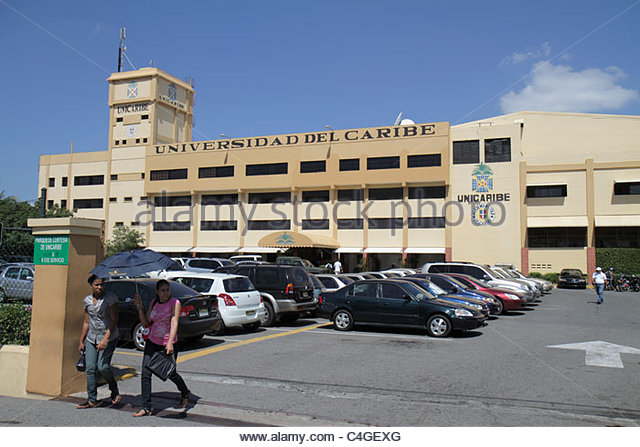 Santo Domingo Dominican Republic Malecon Universidad del Caribe college campus higher education building parking - Stock Image