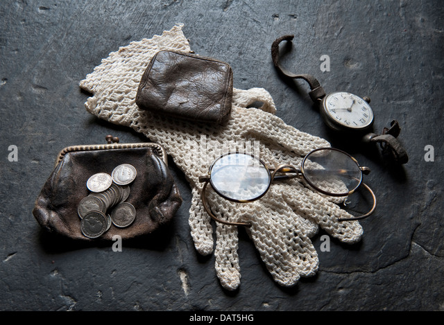 The belongings of a poor Edwardian lady - purse, gloves, spectacles, watch etc, in a reconstruction of a typical - Stock Image