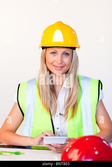 Woman with hard hat looking at drawing - Stock Image