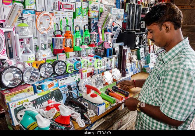 Mumbai India Indian Asian Fort Mumbai Kala Ghoda Nagindas Master Road sidewalk street vendor stall shopping display - Stock Image