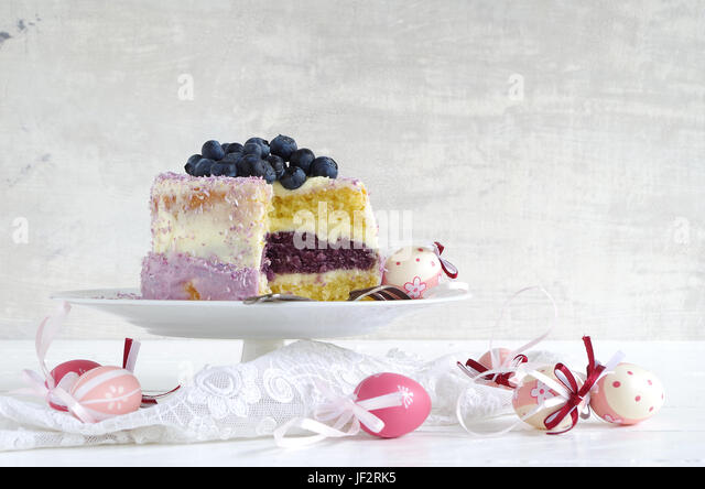 buttercreme cake with blueberries to easter - Stock Image