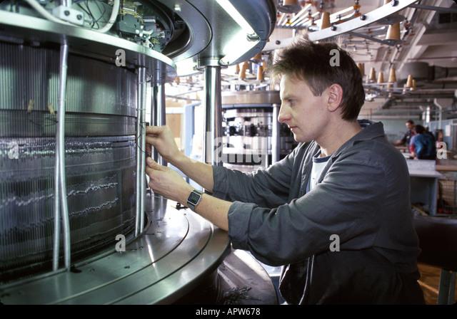 Ukraine Eastern Europe Brovari textile mill machinery repairman - Stock Image