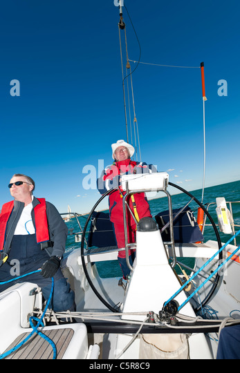 Ocean going yacht with captain at the wheel. - Stock-Bilder