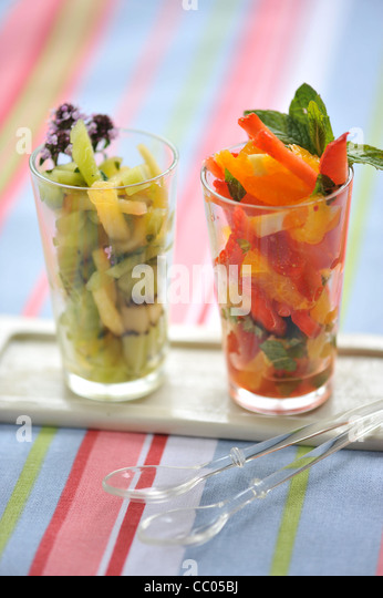 Fruits and Fresh Herbs in Glass Cup - Stock Image