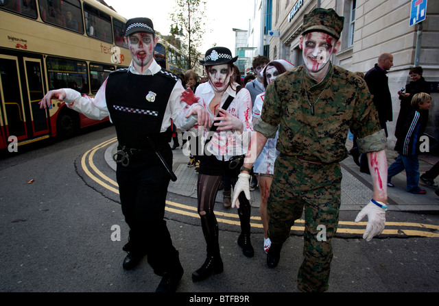 Two girls taking part in the Zombie Walk in Brighton, East Sussex, UK. - Stock Image