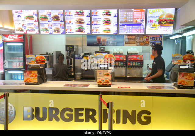 Hong Kong China Island Fortress Hill King's Road Burger King fast food restaurant counter menu Cantonese characters - Stock Image