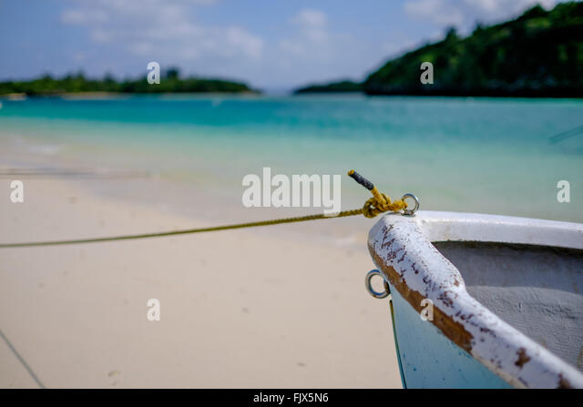 Close-Up Of Cropped Boat Moored On Sea - Stock Image
