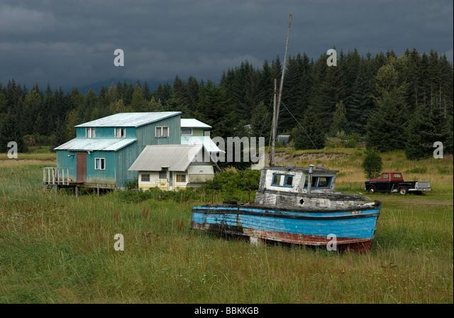 Old boat in someones yard in Gustavus Alaska USA - Stock Image