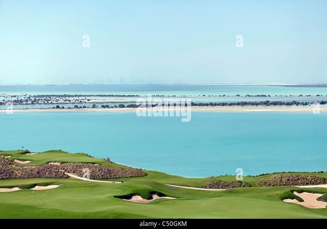 Yas Links Golf Course on Yas Island, skyline of Abu Dhabi at the back, Abu Dhabi, United Arab Emirates, Middle East, - Stock Image