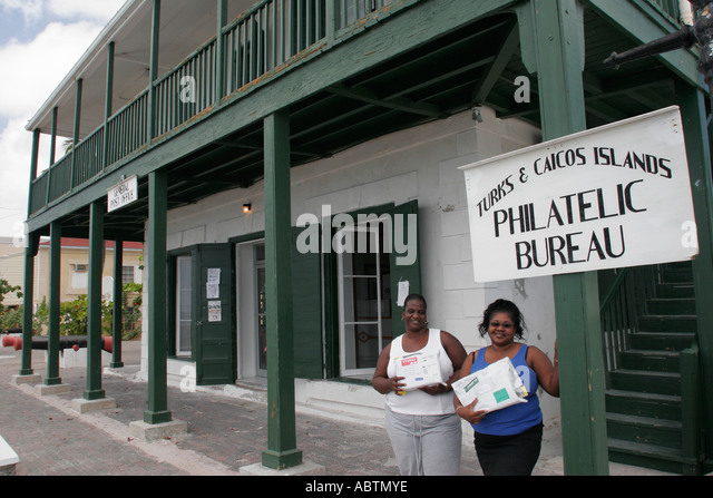Grand Turk Cockburn Town Front Street Franklin Missick Building Philatelic Bureau Black female postal workers - Stock Image