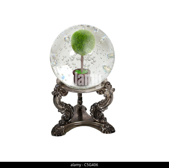 The future of ecology shown by a crystal ball and tree in a pot inside - path included - Stock Image