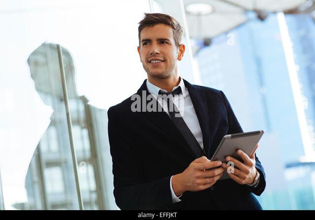 Businessman using a digital tablet - Stock-Bilder