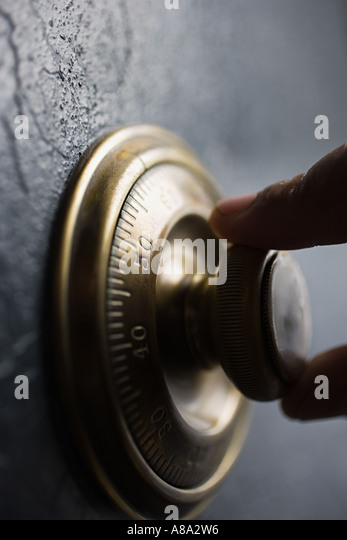 Person opening a security safe - Stock Image