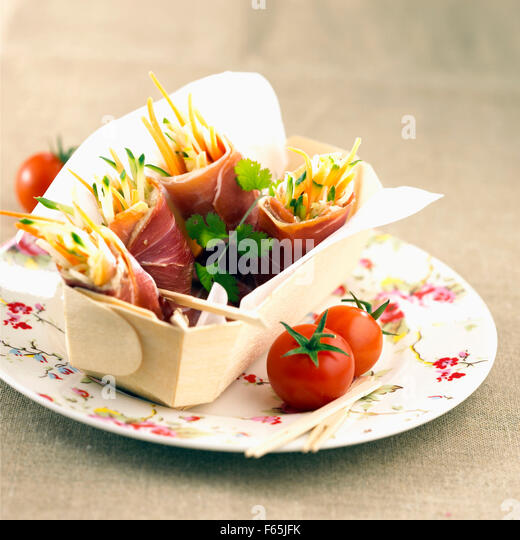 raw ham and vegetable wraps - Stock Image