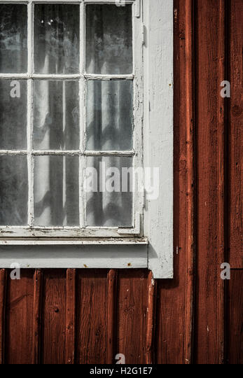Window of red cabin. Old building exterior, Sweden. - Stock-Bilder