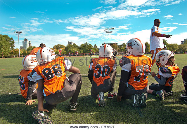 NEW  YORK: an american football match on a sunny Satday in MC Carren Park Brooklyn - Stock Image