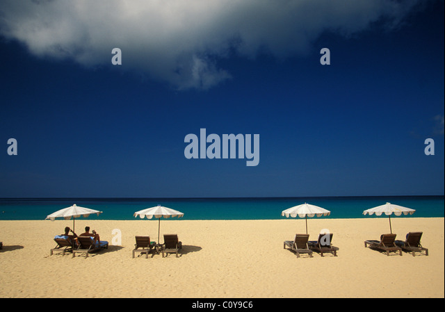 Chaises loungers and parasols on beach in Phuket Southern Thailand - Stock Image